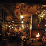 Warm up with a hot toddy by the fireplace at Spritzenhaus and play Jenga with friends. (33 Nassau Ave Brooklyn, NY 11222) Photo by @ecemen.