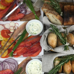 This Brooklyn-based catering company specializes in seasonal rustic menus such as the beet cured salmon and smoked trout platter. Photo via @poppyscatering. (www.poppyscatering.com)