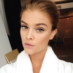 @ninaagdal takes a classic robe selfie near one of our large windows.
