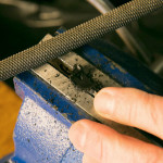 A rat tail file is an excellent tool to remove any plastic ridges that hold smaller gauge wires.